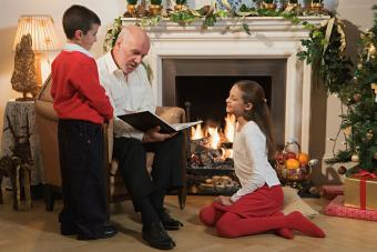 Grandfather and children reading
