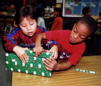 OCC_1-_two_children_opening_shoebox.jpg