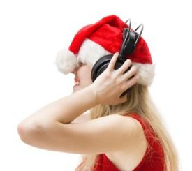 Woman listening to dirty Christmas carols