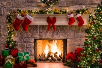 Christmas tree and stockings over fireplace