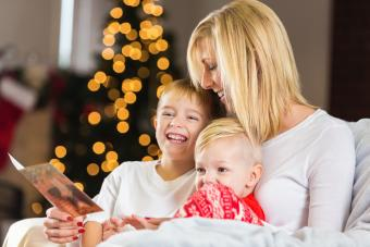 Mother looking at Christmas card with adorable little boys