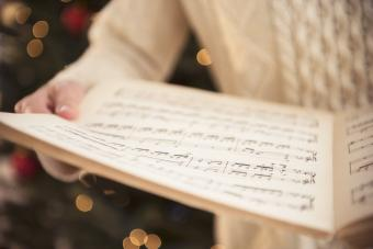 Woman holding sheet music at christmas