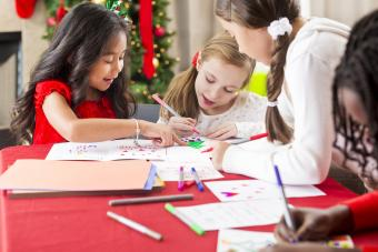 Girls making Christmas cards