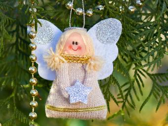 Christmas angel on a tree branch