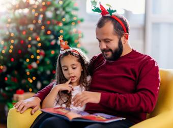 Father and daughter reading Christmas poetry together