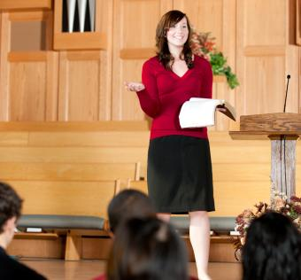 Young woman giving a speech in church