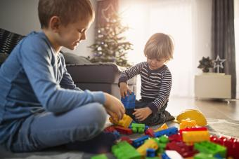 Little boys on christmas morning playing with new blocks
