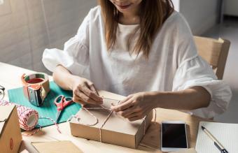 Woman packing gift box