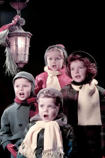 Four Children Sing Carols Under Lantern