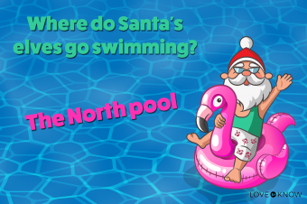 Santa Clauses with Flamingo on a pool