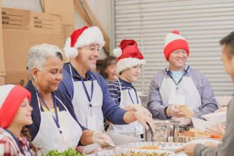 volunteers serves food at soup kitchen