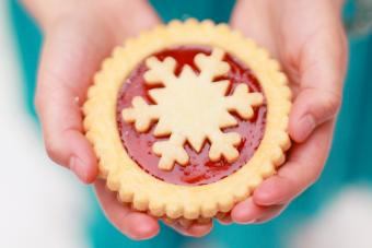 Girl holding Christmas cookie