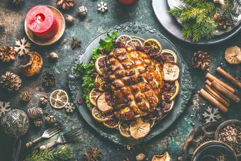 Christmas dinner table with roasted pork ham