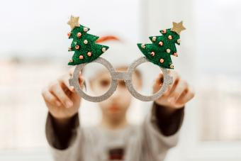 Boy with santa hat and funny xmas glasses