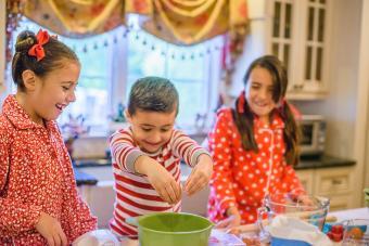 Children in kitchen wearing pijamas and making cookies