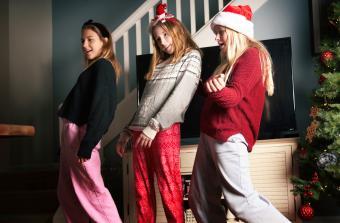 Teenage girls having fun during Christmas time