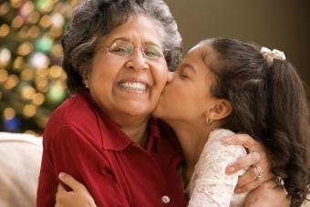 Granddaughter kissing grandmother at Christmas time