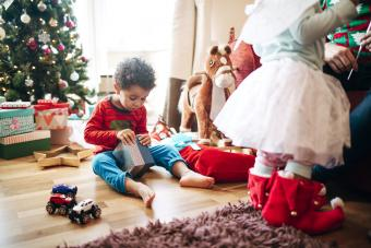 Little Boy Opening a Gift at Christmas Time