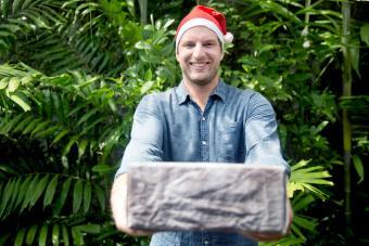 Man giving christmas present