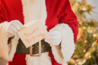 Santa Claus holding letter in North Pole