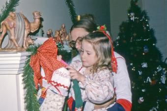 Mom helps daughter reach Christmas stocking