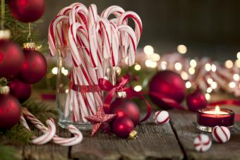 Candy Canes and Bright Christmas Lights on an Old Wood Background