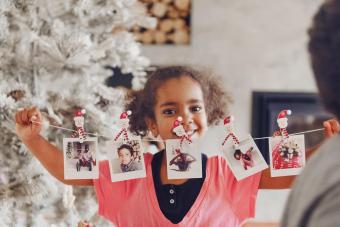Little girl holding polaroid pictures