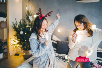 Teen girls listening to music on Christmas