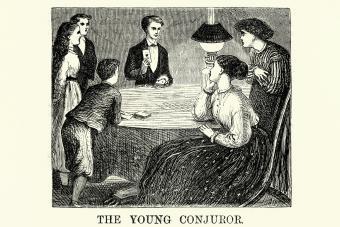 Victorian boy doing a card trick