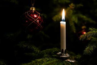 Illuminated Candle On Christmas Tree