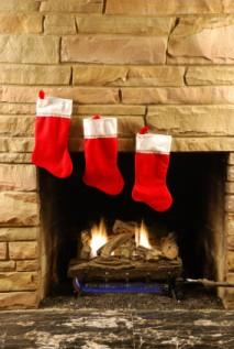 Three Christmas stocking hung on the mantle