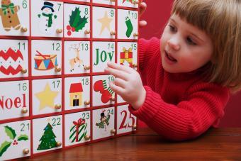 Small girl with Advent calendar
