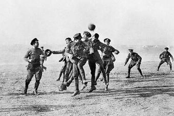 Soldiers playing football in No-Man's Land