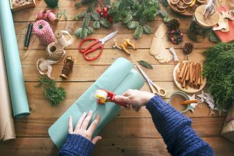 Woman's hands wrapping christmas gifts