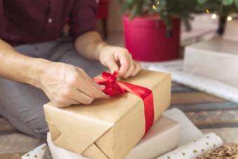 Man Wrapping Christmas Present