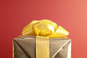 Christmas gift with gold ribbon