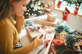 Women wrapping Christmas gifts at home