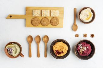 Crackers with assorted healthy snacks, gourmet dips in knolling style