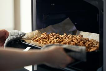 Take the homemade granola out of the oven