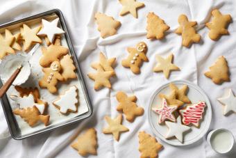 Christmas sugar cookies being iced,