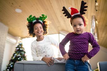 Cute sisters acting like reindeers