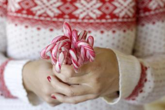 Woman hands holding candy canes