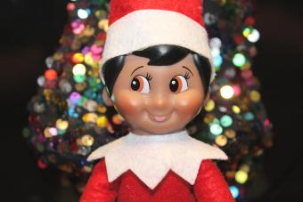 Elf with Christmas decoration background