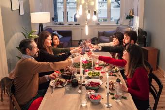 friends toasting wine glasses at dining table during Christmas