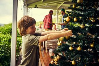 Little boy decorating a Christmas tree