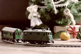 antique train around Christmas tree