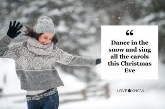 Woman wearing knitwear dancing in the snow