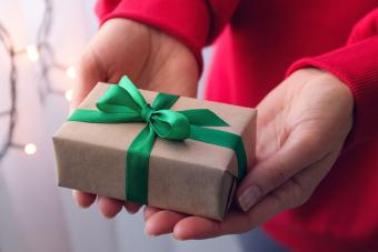 give gift present with green ribbon