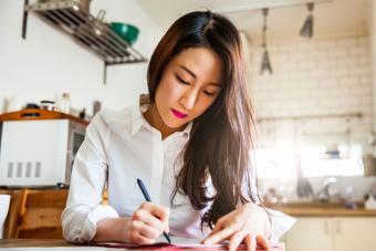 Korean woman writing Christmas cards
