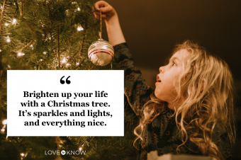 Little Girl Decorating Christmas Tree with Ornaments